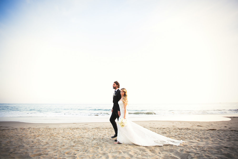 Four Seasons Santa Barbara Wedding - Hand in Hand on the Beach