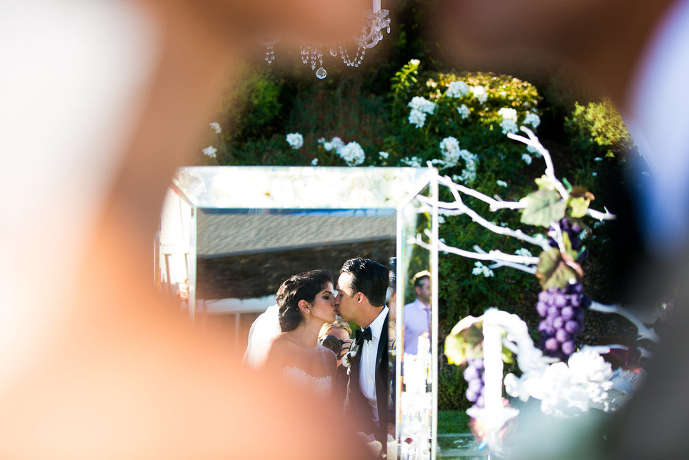 Great kiss moment at Persian wedding at Solage