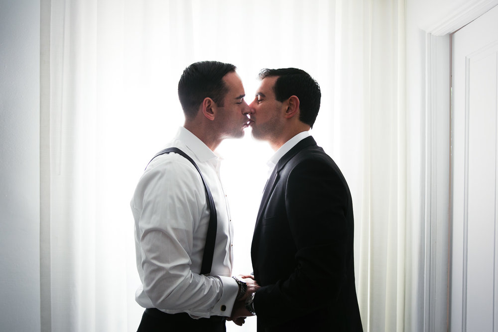 Same Sex Avalon Palm Springs Wedding - Kissing While Getting Ready