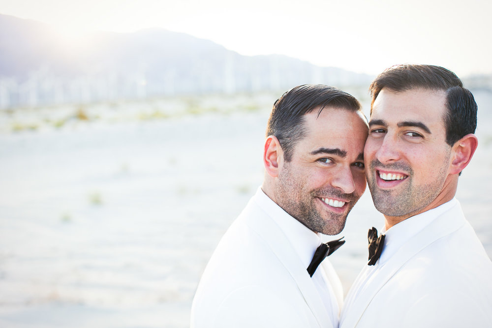 Same Sex Avalon Palm Springs Wedding - Embracing Before Reception