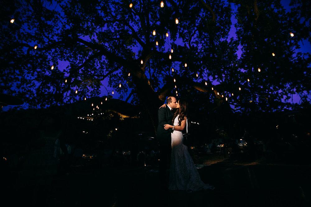 Los Olivos Wedding - Kissing in pretty wedding reception