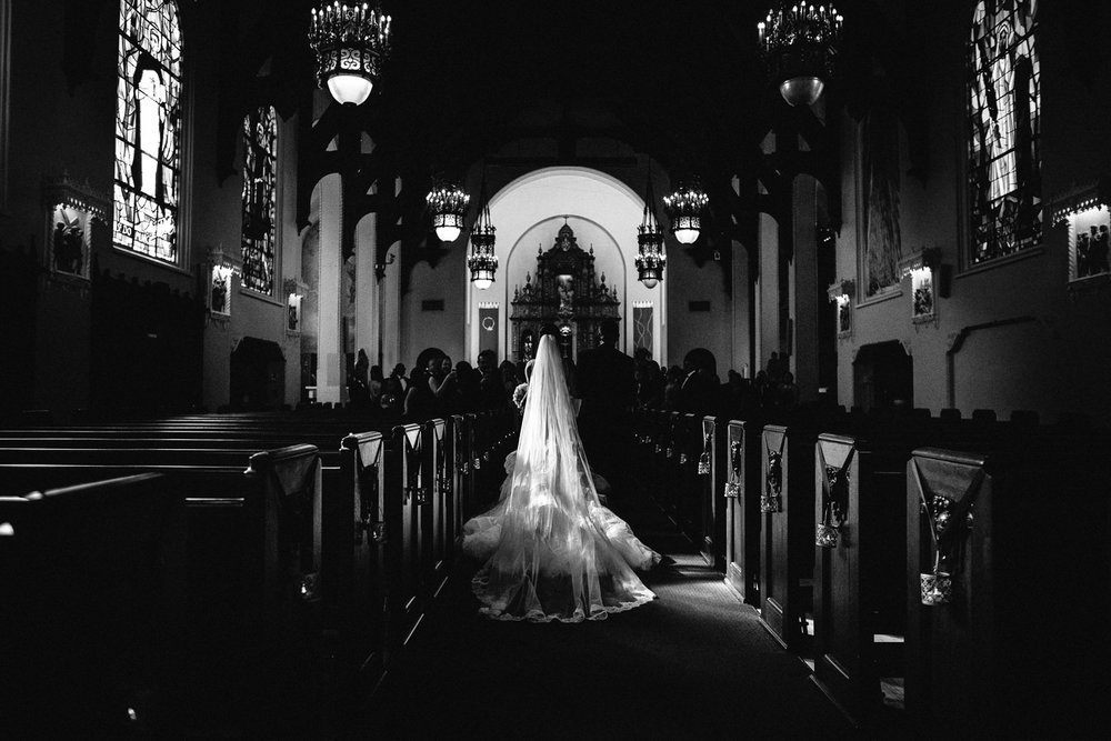 City Club LA wedding - Bride going down the aisle
