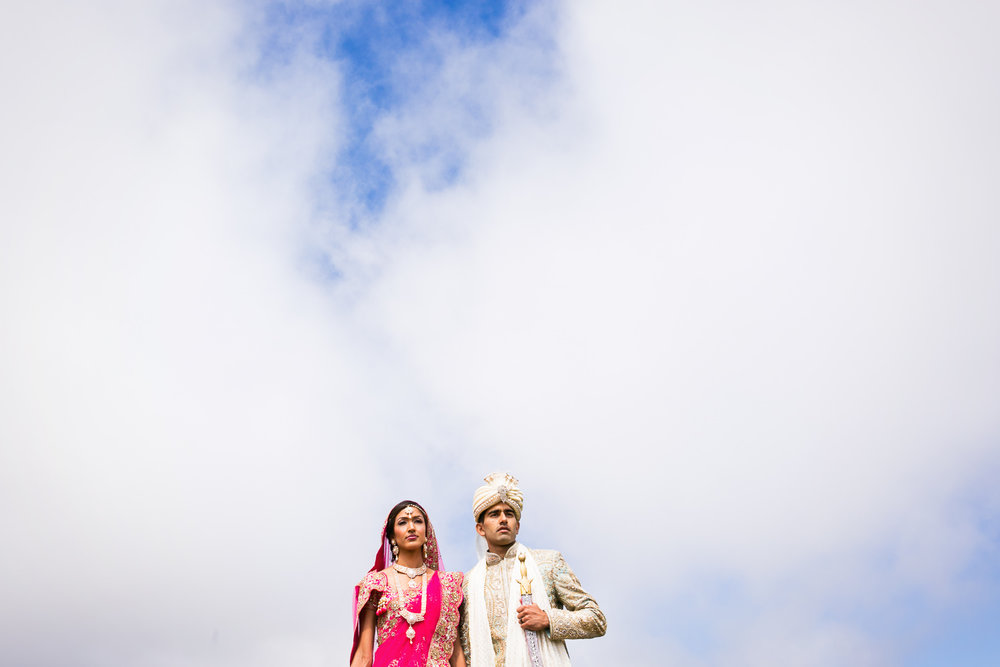 South Asian Trump National Golf Club Wedding - Bride with Groom Framed by the Sky