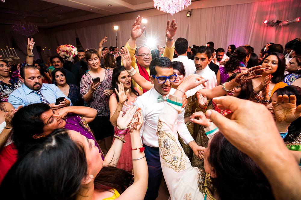 Trump National Golf Club Wedding - Groom Dancing at Reception