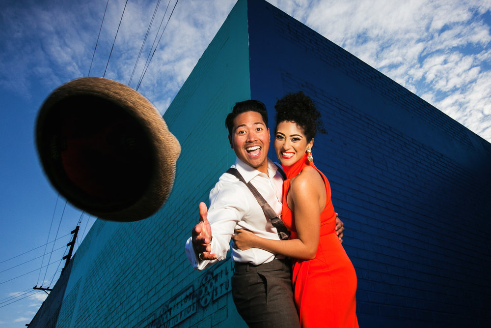 Fashionable Engagement in Downtown Los Angeles - Throwing His Hat