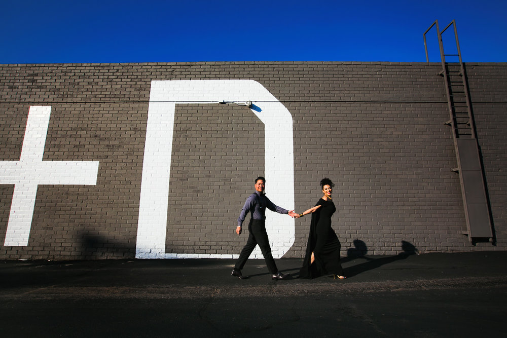 Fashionable Engagement in Downtown Los Angeles - Walking together Hand in Hand