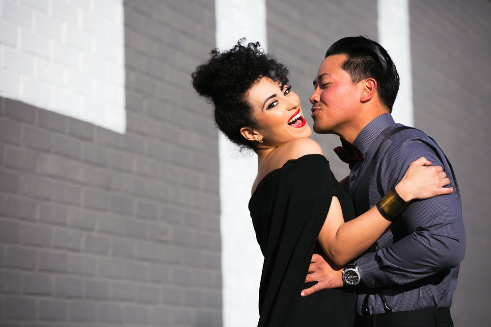 Fashionable Engagement in Downtown Los Angeles - Him kissing Her