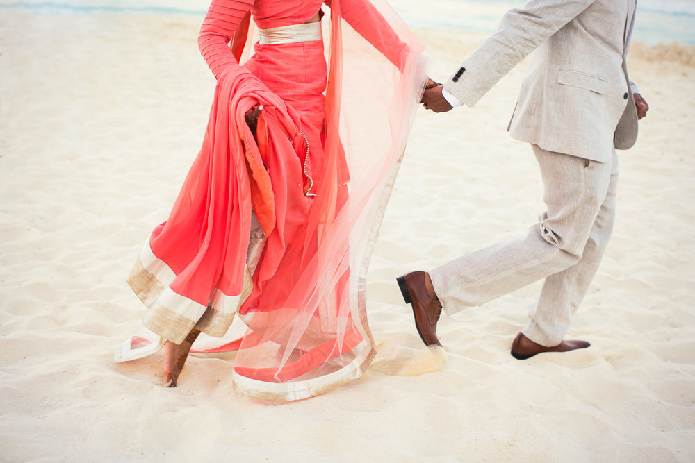 Paradisus Cancun Indian Wedding - Bride and Groom Hand in Hand in the Sand