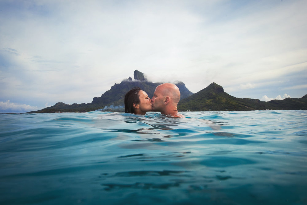 Four Seasons Bora Bora Wedding - Kissing in the ocean