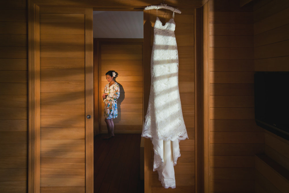 Four Seasons Bora Bora Wedding - Bride getting ready with the dress
