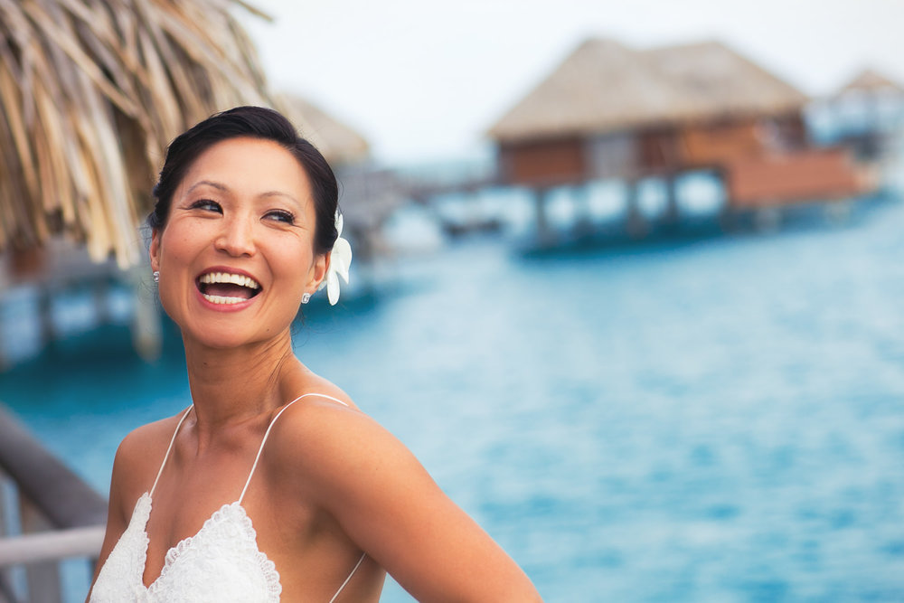 Four Seasons Bora Bora Wedding - Gorgeous Bride Laughing