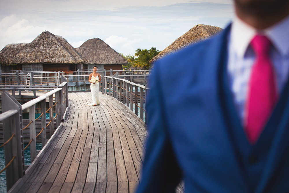 Four Seasons Bora Bora Wedding - Bride walking toward Groom