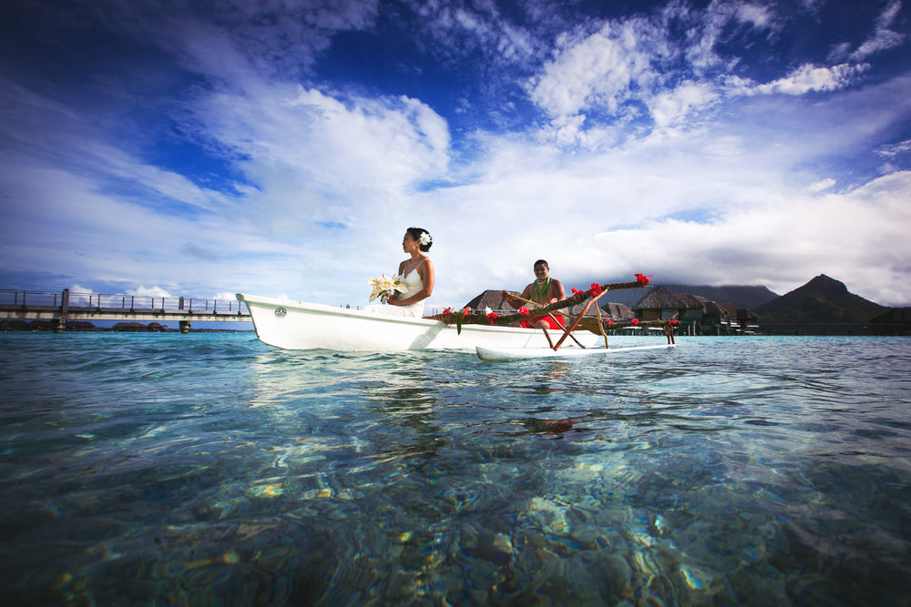 Four Seasons Bora Bora Wedding - Bride being rowed to her ceremony on the ocean