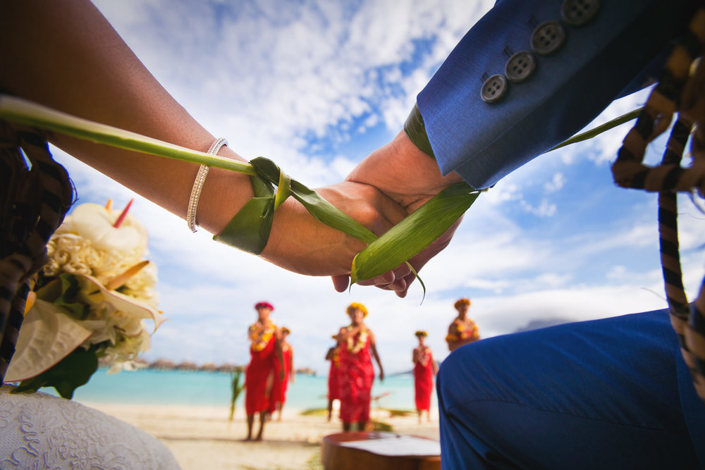 Four Seasons Bora Bora Wedding - Hands tied in tradition