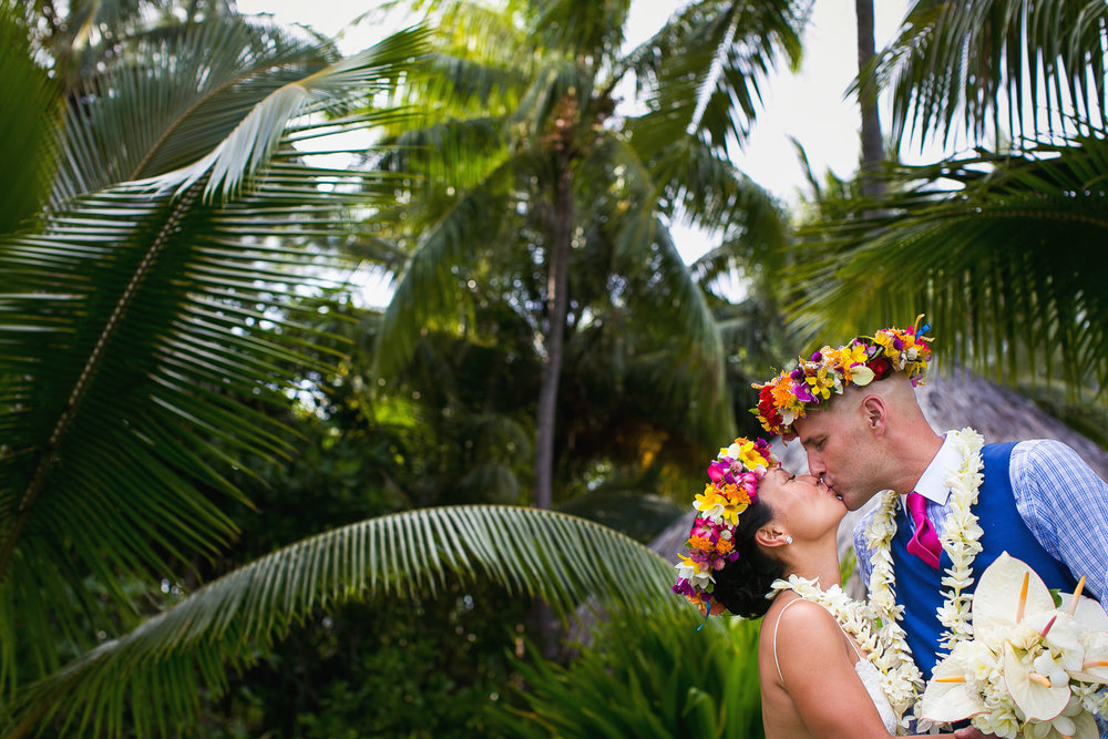 Four Seasons Bora Bora Wedding - Kissing under the palms