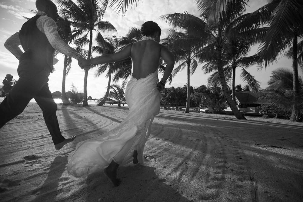 Four Seasons Bora Bora Wedding - Gorgeous Black and White of newly weds hand in hand