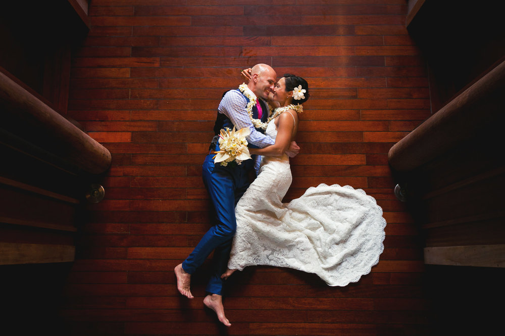 Four Seasons Bora Bora Wedding - Embracing on the hard wood floor