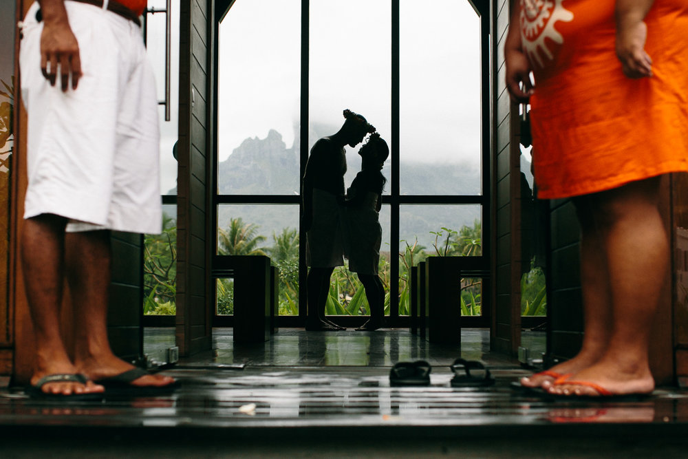 Four Seasons Bora Bora Wedding - Kissing in the window light