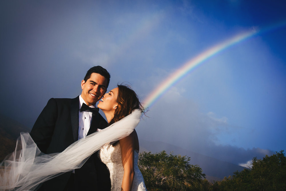 Hyatt Regency Maui Wedding - Holding each other with the rainbow