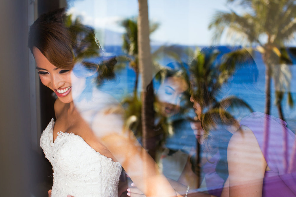 Hyatt Regency Maui Wedding - Bride putting on her dress