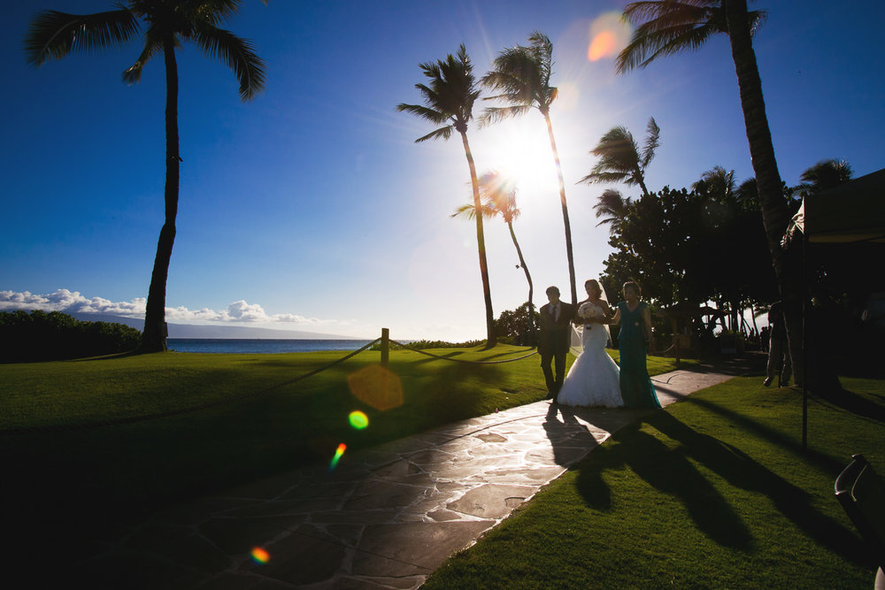 Hyatt Regency Maui Wedding - Bride walking under stunning sky