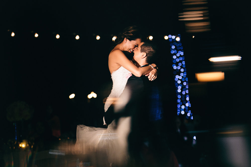 Hyatt Regency Maui Wedding - Kissing at their reception