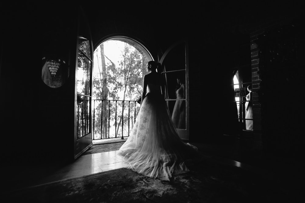 Rose McGowan Wedding at Paramour Estate - Black and white of bride at doorway to balcony