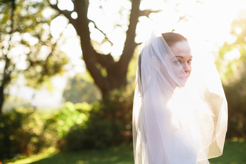 Rose McGowan Wedding at Paramour Estate - Beautiful natural light highlighting the bride outside
