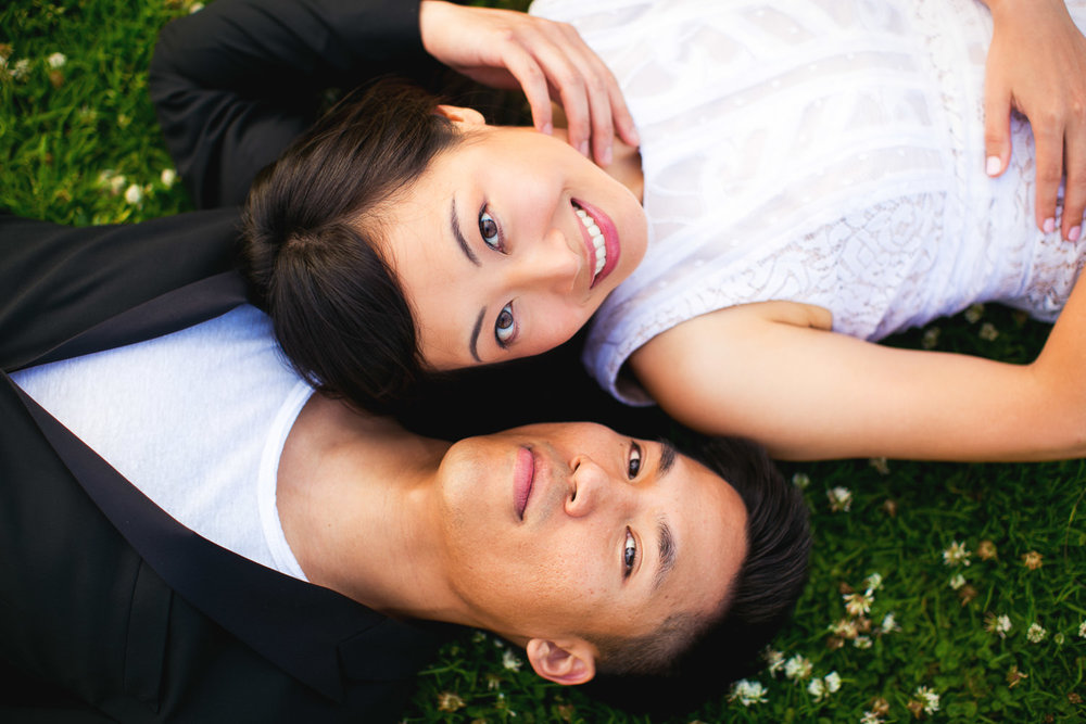 Venice Beach Engagement Photos - Laying on the grass together