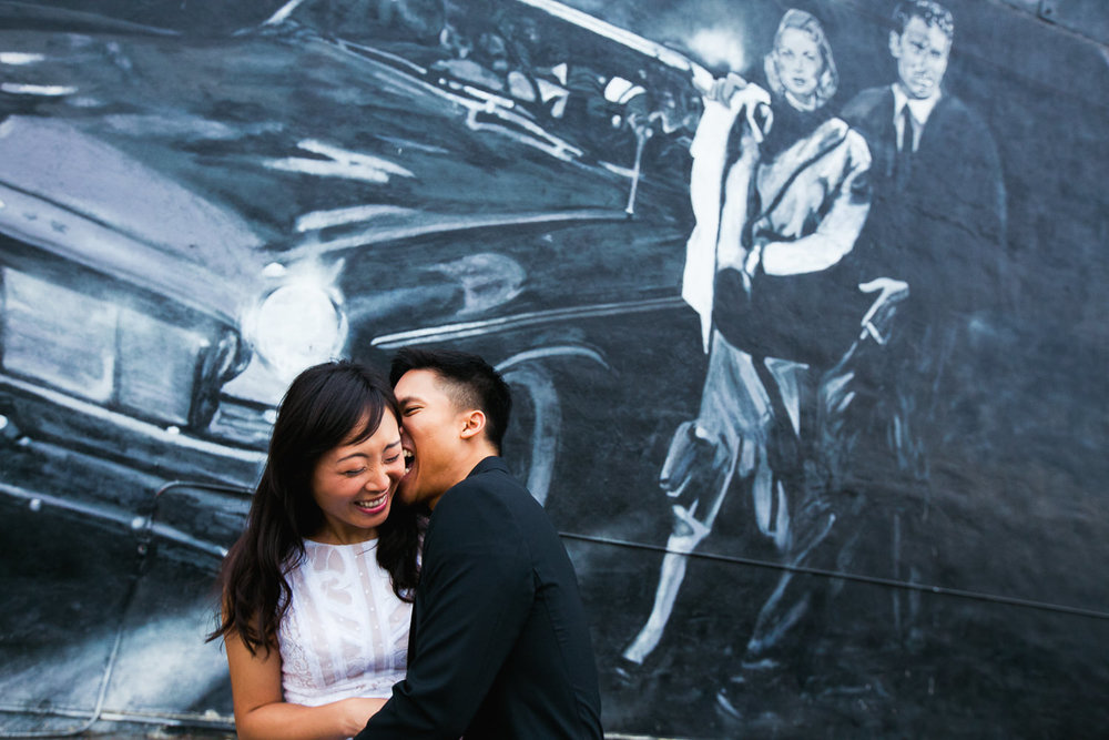 Venice Beach Engagement Photos - Laughing and kissing