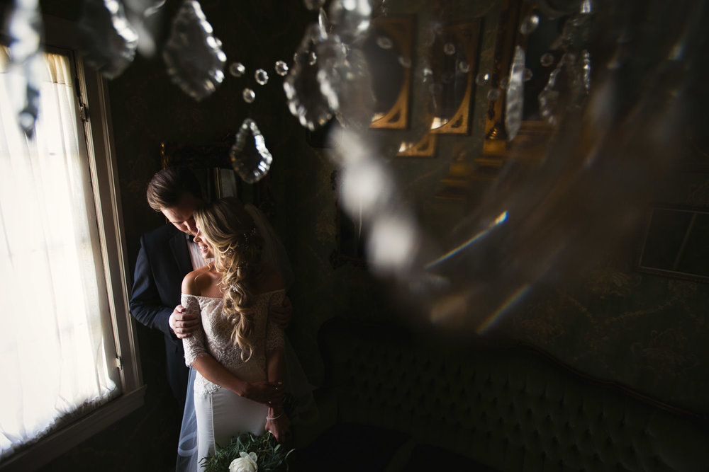 Ebell Long Beach Wedding - Embracing by the windows