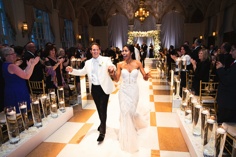 Breakers Palm Beach Wedding - just married walking down the aisle
