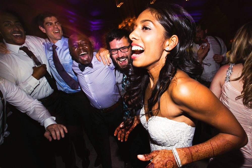 Bride having so much fun dancing at her Breakers Palm Beach Wedding Reception