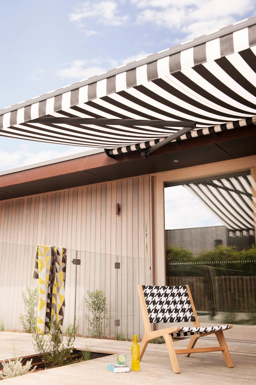 Brax window treatments striped awning 2.jpg