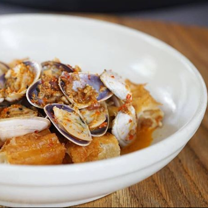 Petition Kitchen: Clams, aged ham, fermented shrimp butter