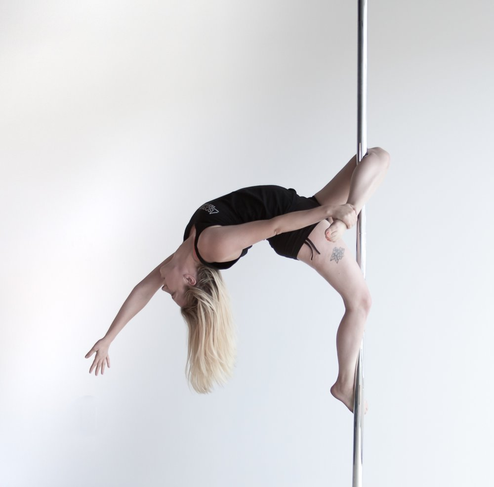 Catherine Budinger  IG:  @flexy_cat   Catherine began pole dancing in 2016 when looking for a fitness activity that would counteract sitting at a desk most of the day. After taking a few beginner classes, she quickly realized this not only would help her gain strength and stamina, but also confidence and creativity. You will see her around the studio taking pole, lyra and aerial yoga. Additionally, Catherine is excited to take the next step in her aerial journey through teaching at our studio.