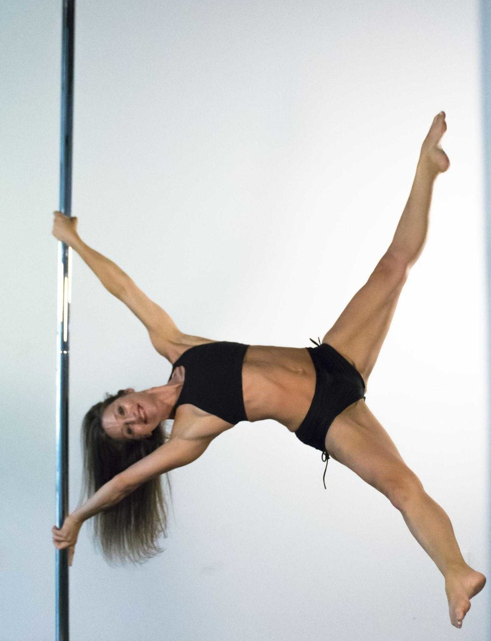 Yael Kallin  IG:  @yaelkallin   Yael is a 12 year pole veteran since 2007, who started with almost no dance or gymnastics background. She fell in love with pole after her first class and never looked back. She is a firm believer in pole being for anyone who really wants it, no matter their gender, size or background. She feels pole can become a lifelong journey with wonderful benefits beyond any initial expectations. No matter how long you have poled, there is always more to learn, and more ways to develop your craft. Yael enjoys teaching all levels from beginner to advanced, with a special love for inversions. You can also find her occasionally competing in local competitions or taking the stage to perform around Seattle. She also poles regularly with her daughter Grace, and specializes in doubling with a partner to create interactive, duet based aerial art. When not poling you can find Yael working full time in advertising sales, jogging, and crafting.