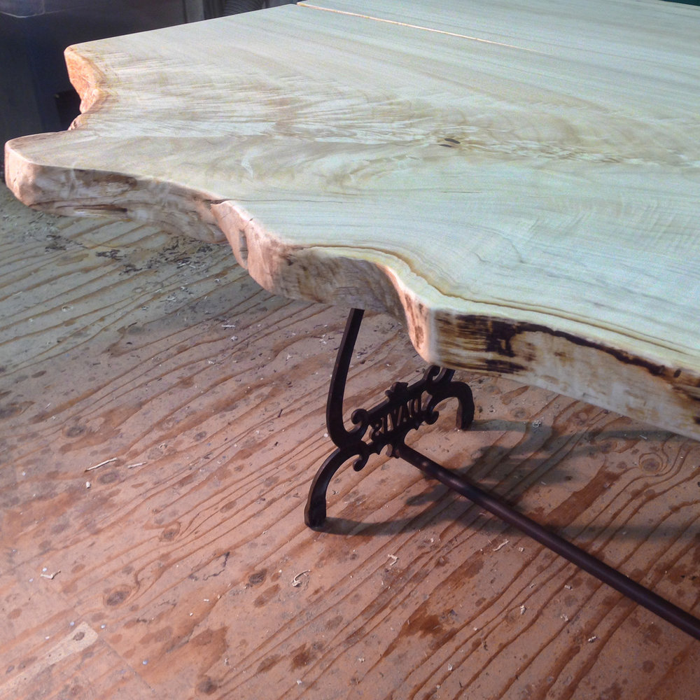Live edge cottonwood slab on a reclaimed Singer sewing machine base.