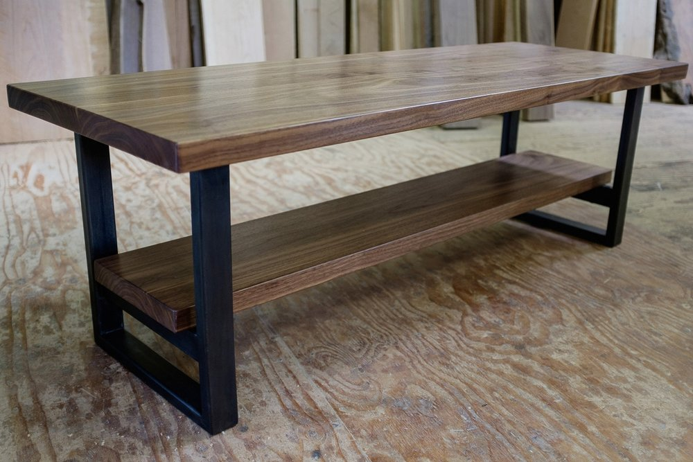 Walnut coffee table with steel base.