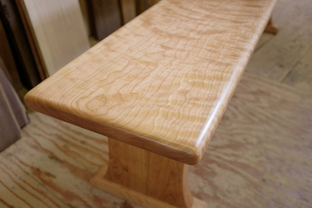 Detail of curly cherry bench top.