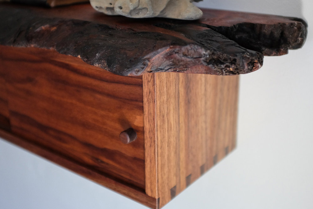 Detail of dovetail and burned live edge on redwood.