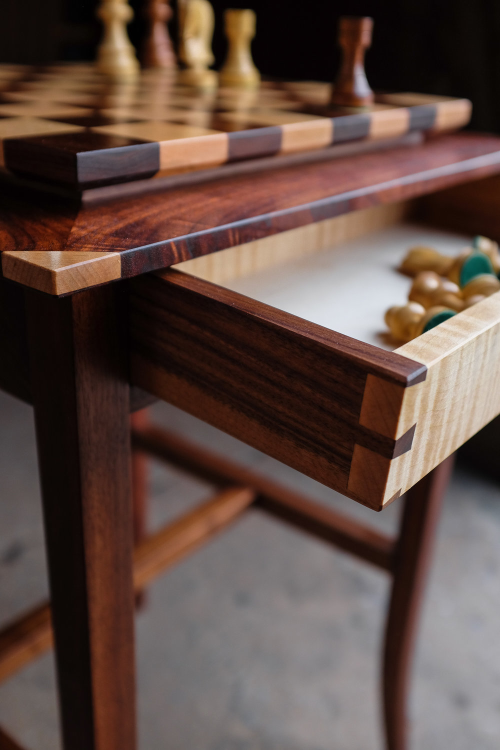 Detail of curly make drawer front with walnut sides. A drawer on the other side of the piece features a walnut front and maple sides, for corresponding pieces.