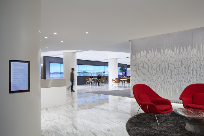 The member wall consists of glass crystals with member names inscribed. A control panel allows guests to find their company on the wall.