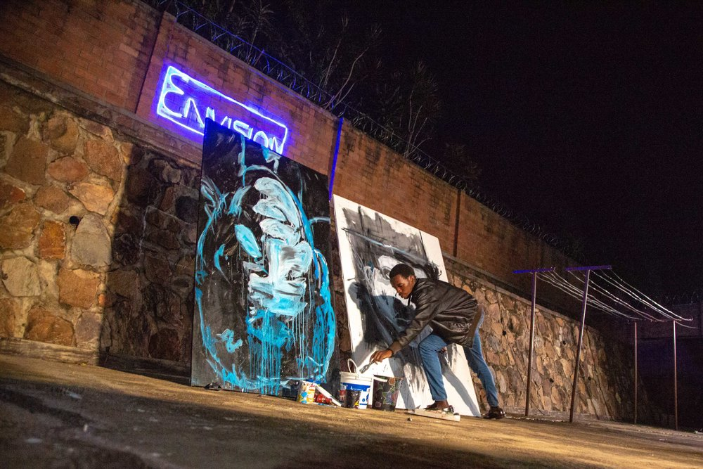 Remy performs a double live painting at the Envision Rwanda grand opening exhibition.  Large portraits of Nelson Mandela and Charlie Chaplin were both completed in 15 minutes.