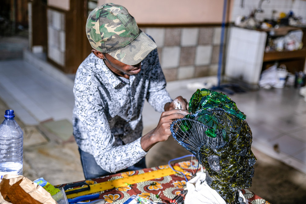 Wire is added to represent the traditional Rwandan hairstyle of a young unmarried woman