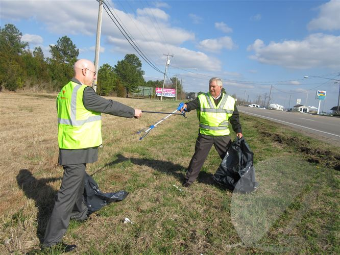 Pasquotank County Manager Sparty Hammett and Camden County Manager Ken Bowman spar over trash.
