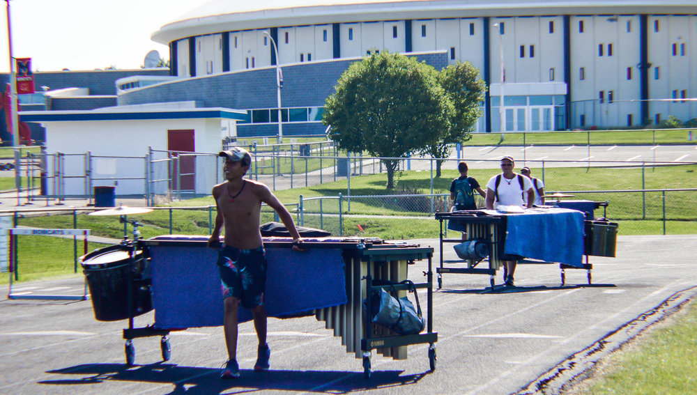 The front ensemble moves to the field before dinner