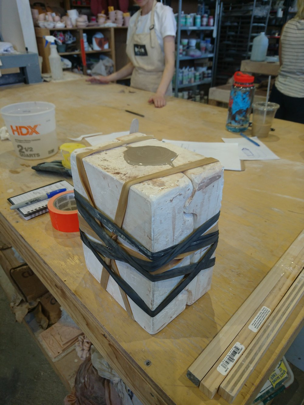 Filling the bottle mould with slip
