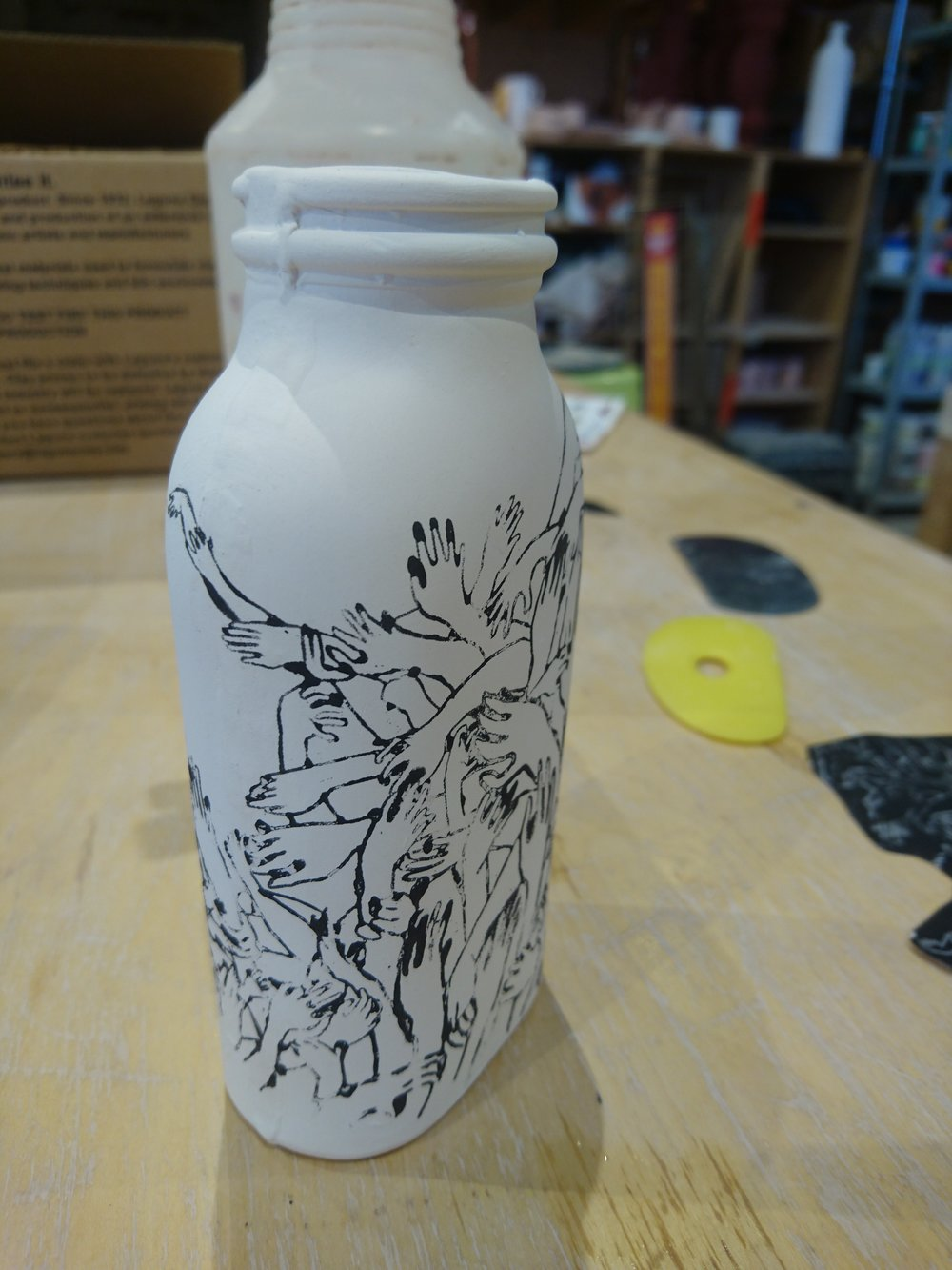 I used a photo transfer technique to make this little bottle. My other one had hand painted designs on it.