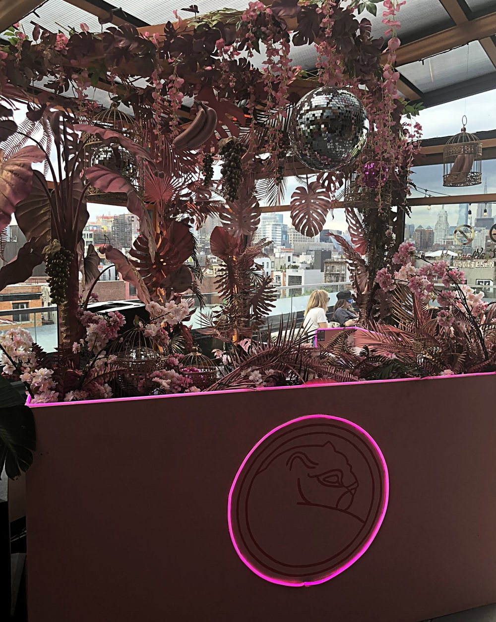 Pink Jungle - Make Believe is one of the newest rooftops on on the East Side and it's interiors speak to the neighborhood and crowd; funky, edgy and fun. Taking different props and painting them one color is a great way to create a purposeful artistic surprise that disassociates itself from the actual prop and adds a whimsical flair. All the details in this space were not missed and we didn't mind the drinks either!